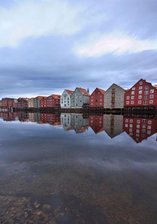 Colorful Wooden Buildings On Nidelva River Trondheim, Norway