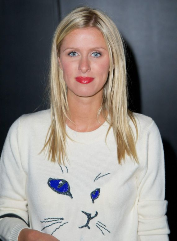 Paris And Nicky Hilton Arriving At Charlotte Ronson Fashion Show